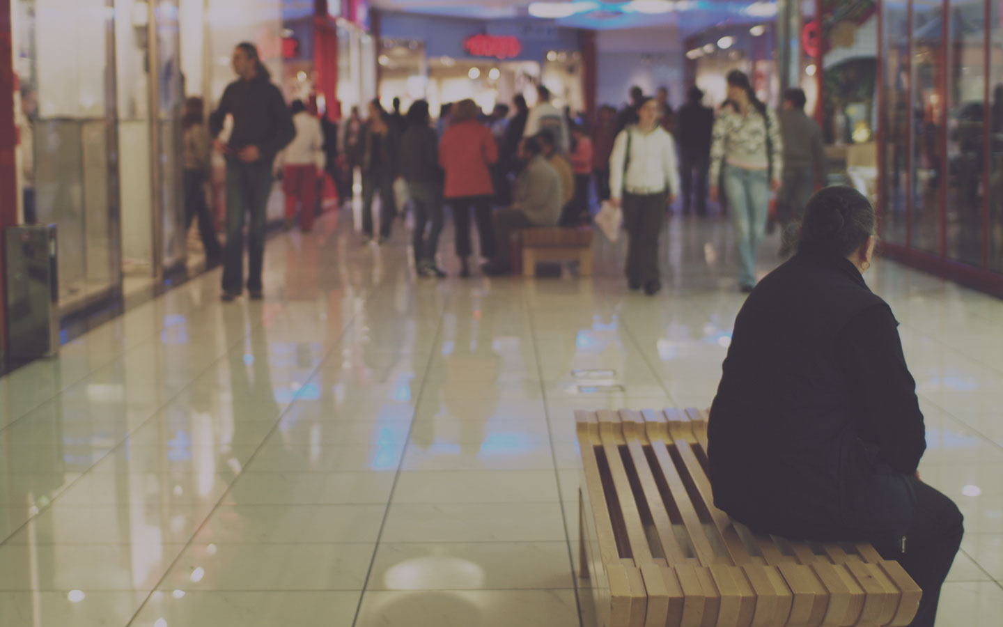 Woman sitting in a shopping mall.